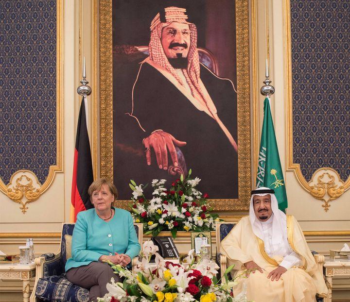 Saudi Arabia's King Salman bin Abdulaziz Al Saud and German Chancellor Angela Merkel attend a deal signing ceremony in Jeddah