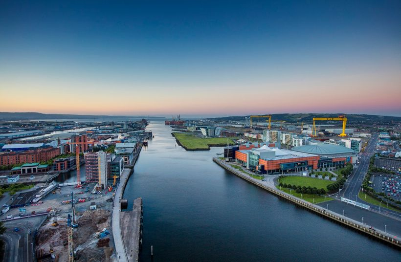 """Belfast's Clarendon Dock area on the River Lagan. The iconic """"Samson and Goliath"""" gantry cranes on right."""