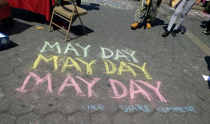 """May Day"" was written in chalk on the sidewalk during the Union Square rally held for immigrants and refugees on May 1."