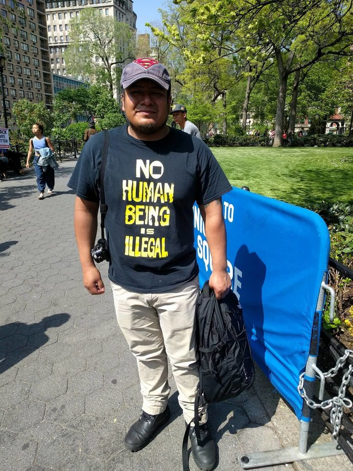 "Jorge Zacatelco, 28, donned a ""no human being is illegal"" shirt to the rally."