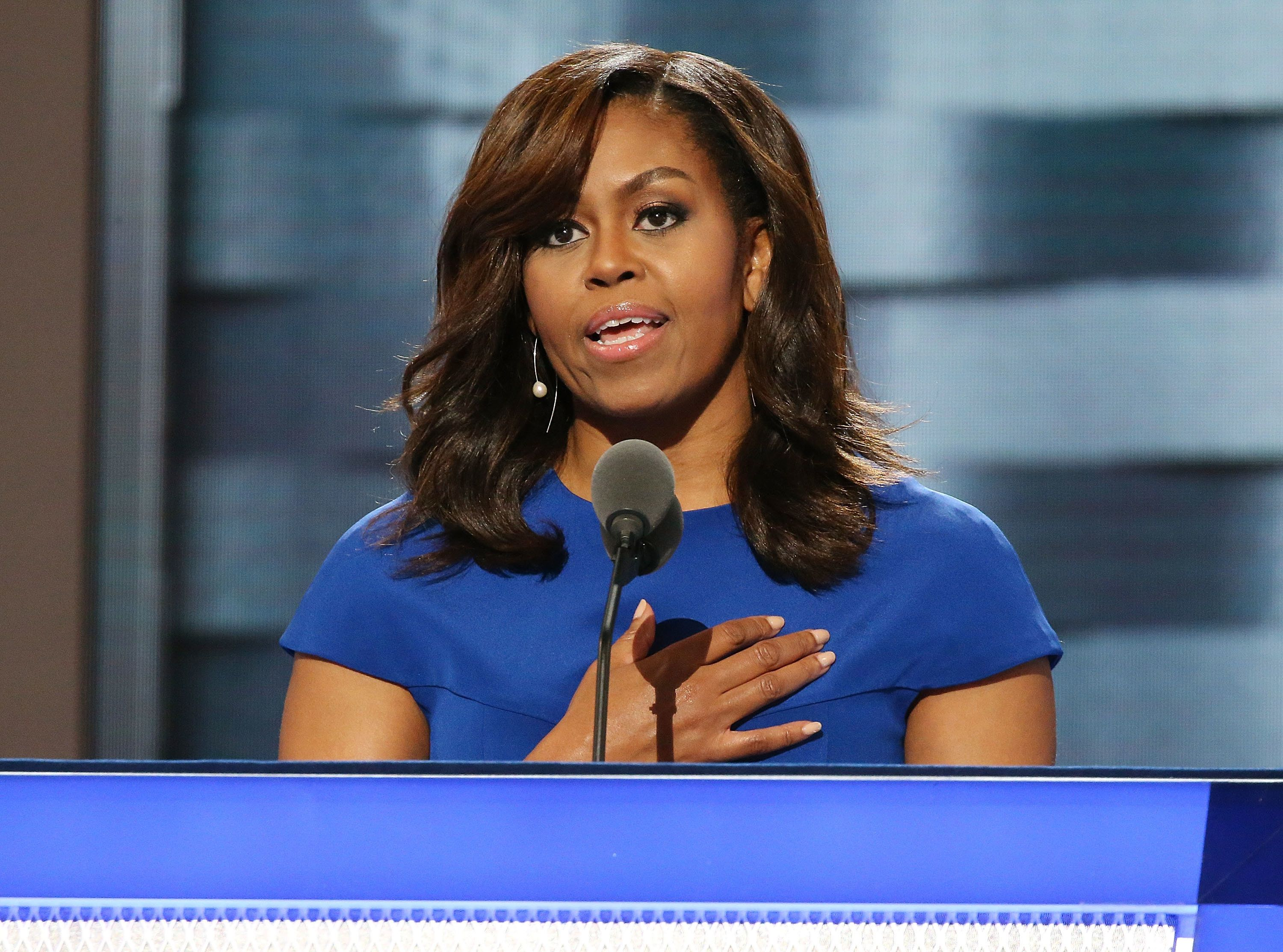 PHILADELPHIA, PA - JULY 25:  First lady Michelle Obama delivers remarks on the first day of the Democratic National Convention at the Wells Fargo Center, July 25, 2016 in Philadelphia, Pennsylvania. An estimated 50,000 people are expected in Philadelphia, including hundreds of protesters and members of the media. The four-day Democratic National Convention kicked off July 25.  (Photo by Paul Morigi/WireImage)