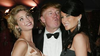 NEW YORK - APRIL 26:  Donald Trump and his daughter Ivanka (left) and girlfriend Melania Knauss (right) attend the 'Dangerous Liaisons: Fashion and Furniture in the 18th Century' Costume Institute benefit gala on April 26, 2004 at the Metropolitan Museum of Art, in New York City. (Photo by Evan Agostini/Getty Images)