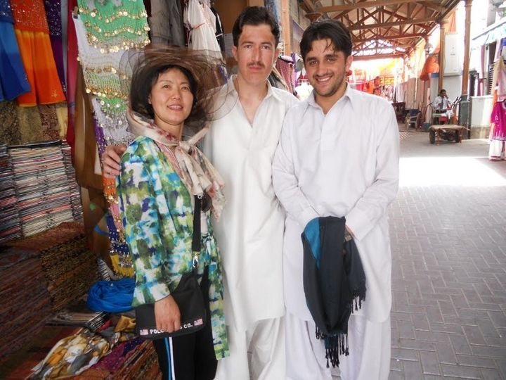 My mom with slightly confused but happy shopkeepers in Dubai. Complete with awkward arm wrap.