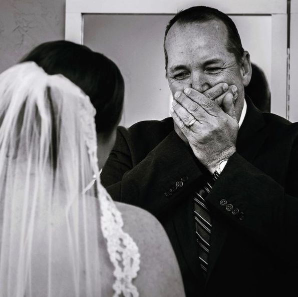 """""""The bride and her dad did a first look before he walked her down the aisle."""" --<i>K & S Photography</i>"""