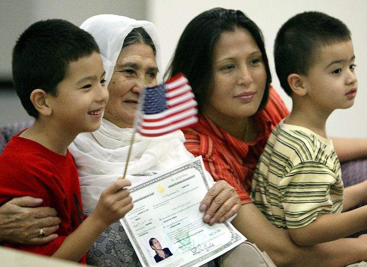 An Afghan family poses for a family photo after their grandmother is sworn in as a U.S. citizen in 2004 in Arlington, Virgini