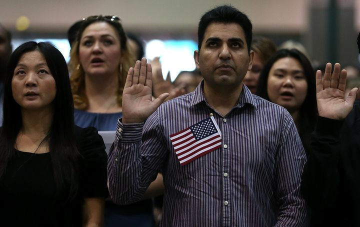Immigrants are sworn in as U.S. citizens during a naturalization ceremony in 2017 in Los Angeles.