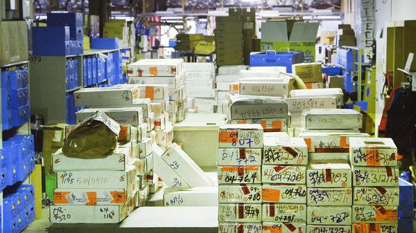 Stacks of untested rape kits in a storage facility.