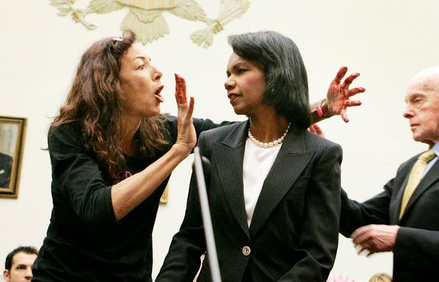 Desiree Fairooz jumps up in front of Secretary of State Condoleezza Rice before Rice testifies on Capitol...