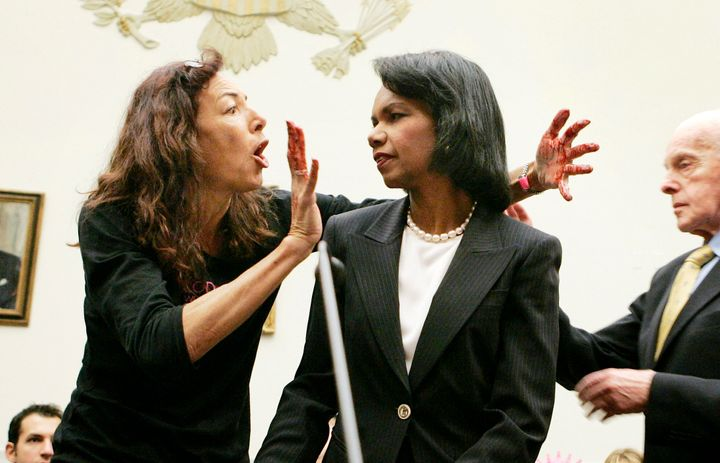 Desiree Fairooz jumps up in front of Secretary of State Condoleezza Rice before Rice testifies on Capitol Hill on Oct. 24, 20