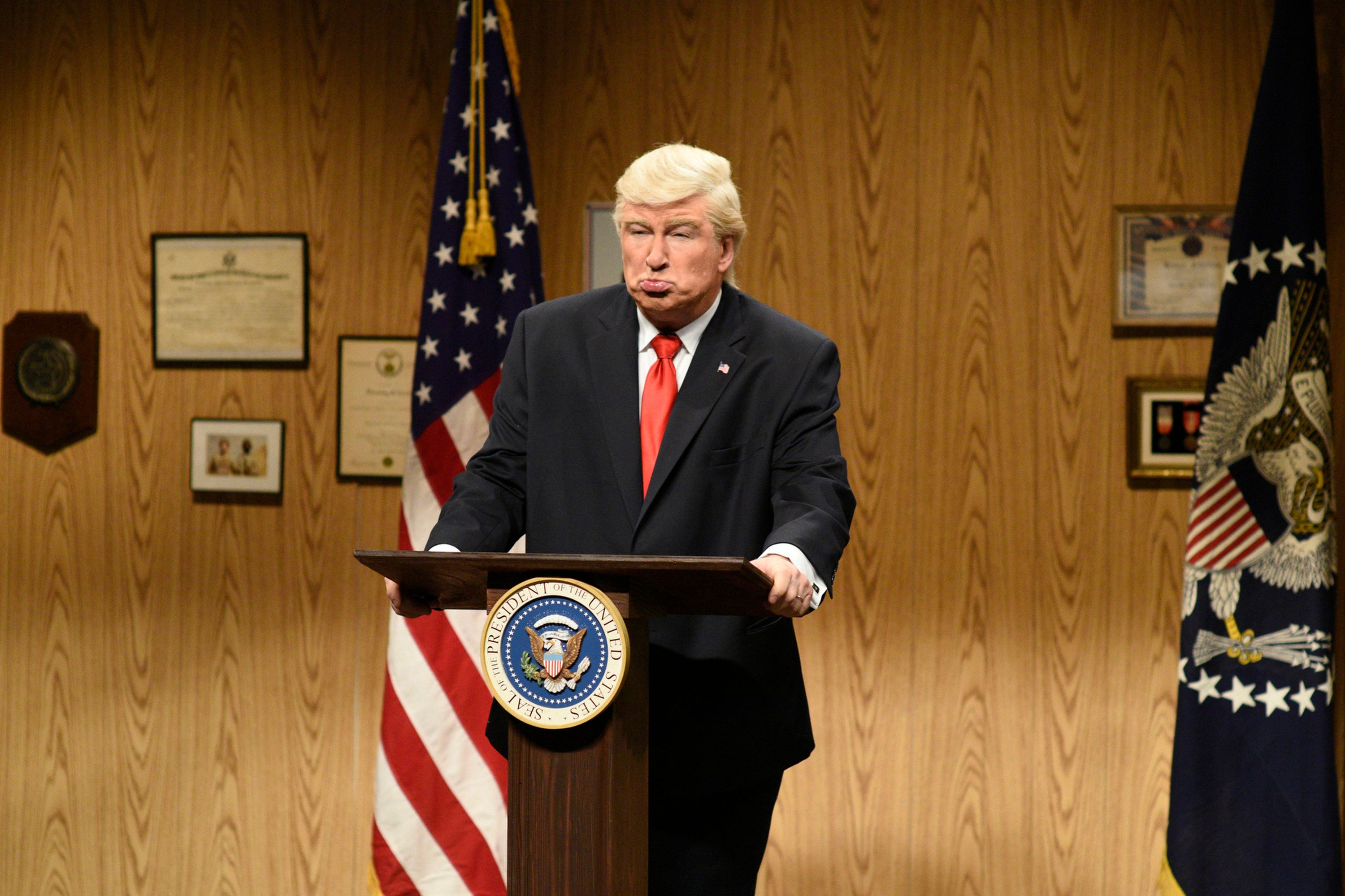 SATURDAY NIGHT LIVE -- 'Louis C.K.' Episode 1721 -- Pictured: (l-r) Alec Baldwin as President Donald Trump during the 'Trump People's Cold Open' on April 8, 2017 -- (Photo by: Will Heath/NBC/NBCU Photo Bank via Getty Images)