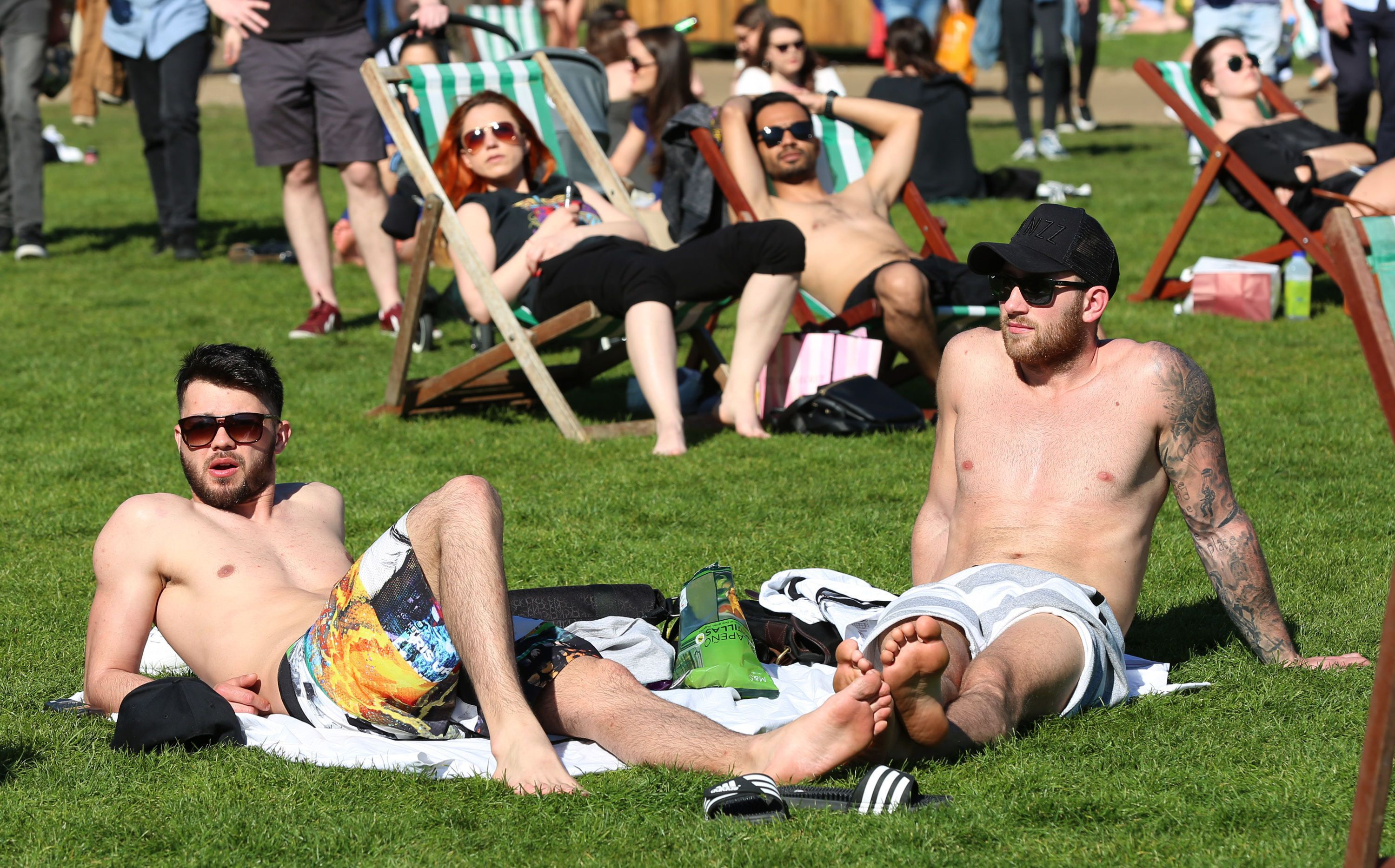 Hopes of a May heatwave have been dashed by the Met Office; sunbathers are pictured about in Green Park,...