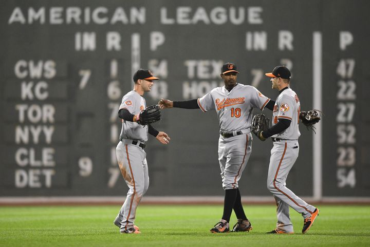 Adam Jones (10) celebrates a victory over the Boston Red Sox after bigoted fans taunted him.