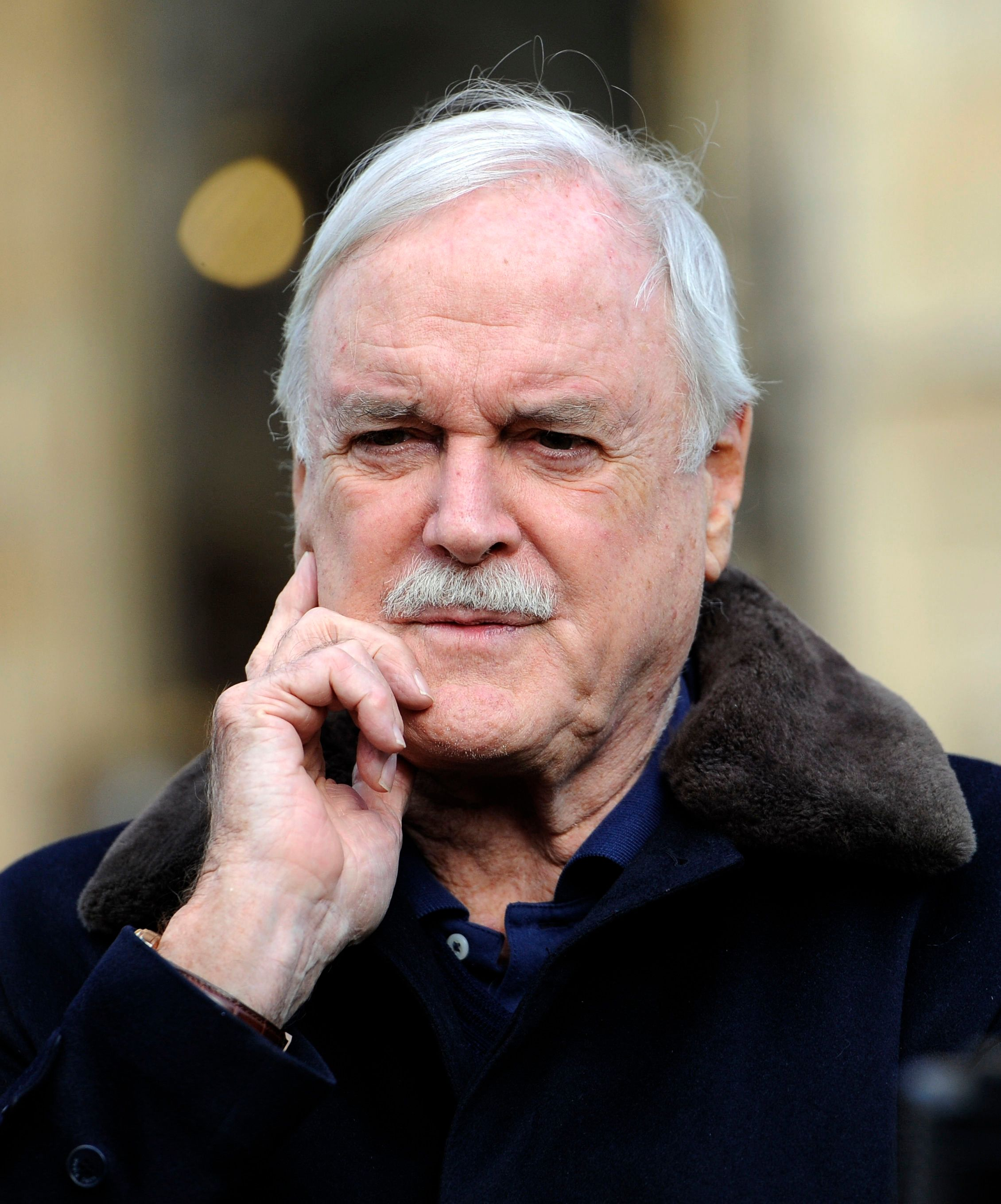 John Cleese Reveals What Really Began His Feud With Piers Morgan