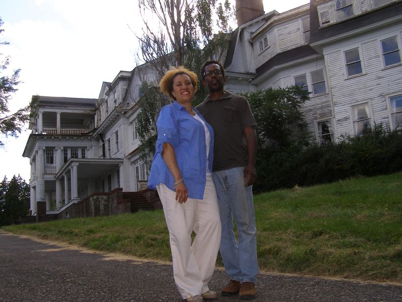 """Monique Greenwood and Glenn Pogue in front of <a rel=""""nofollow"""" href=""""http://www.wayneindependent.com/article/20110718/NEWS/3"""