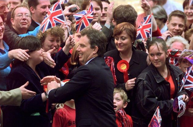 Tony Blair arrives in Downing Street after storming to victory in the 1997 General