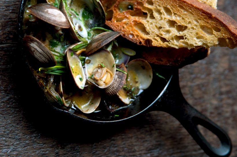 Clams cooked in sherry, served with green garlic and toast