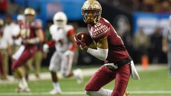 Dec 31, 2015; Atlanta, GA, USA; Florida State Seminoles wide receiver Travis Rudolph (15) carries the ball to score a touchdown against the Houston Cougars during the second half in the 2015 Chick-fil-A Peach Bowl at the Georgia Dome. The Cougars won 38-24. Mandatory Credit: Dale Zanine-USA TODAY Sports