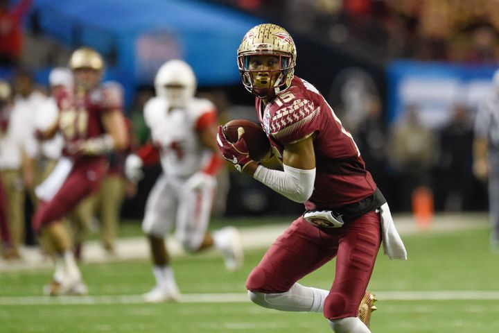 Florida State Seminoles wide receiver Travis Rudolph (15) carries the ball to score a touchdown.