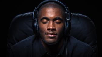 Portrait of a very relaxed man listening to music on headphones with his eyes closed.
