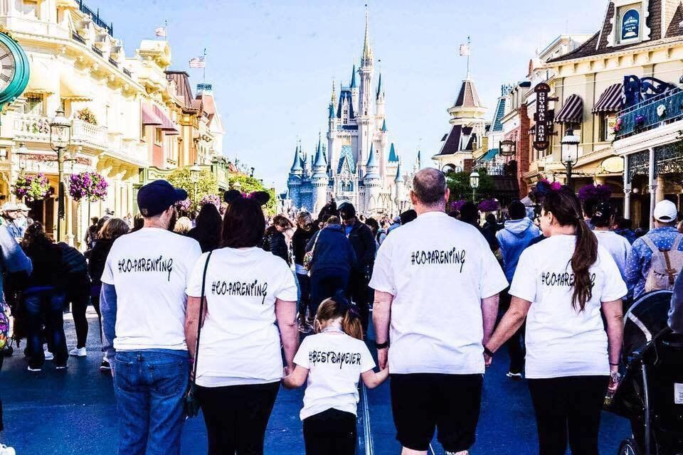 "During a visit to Disney World, a family proudly wore shirts that had ""#CO-PARENTING"" on them."