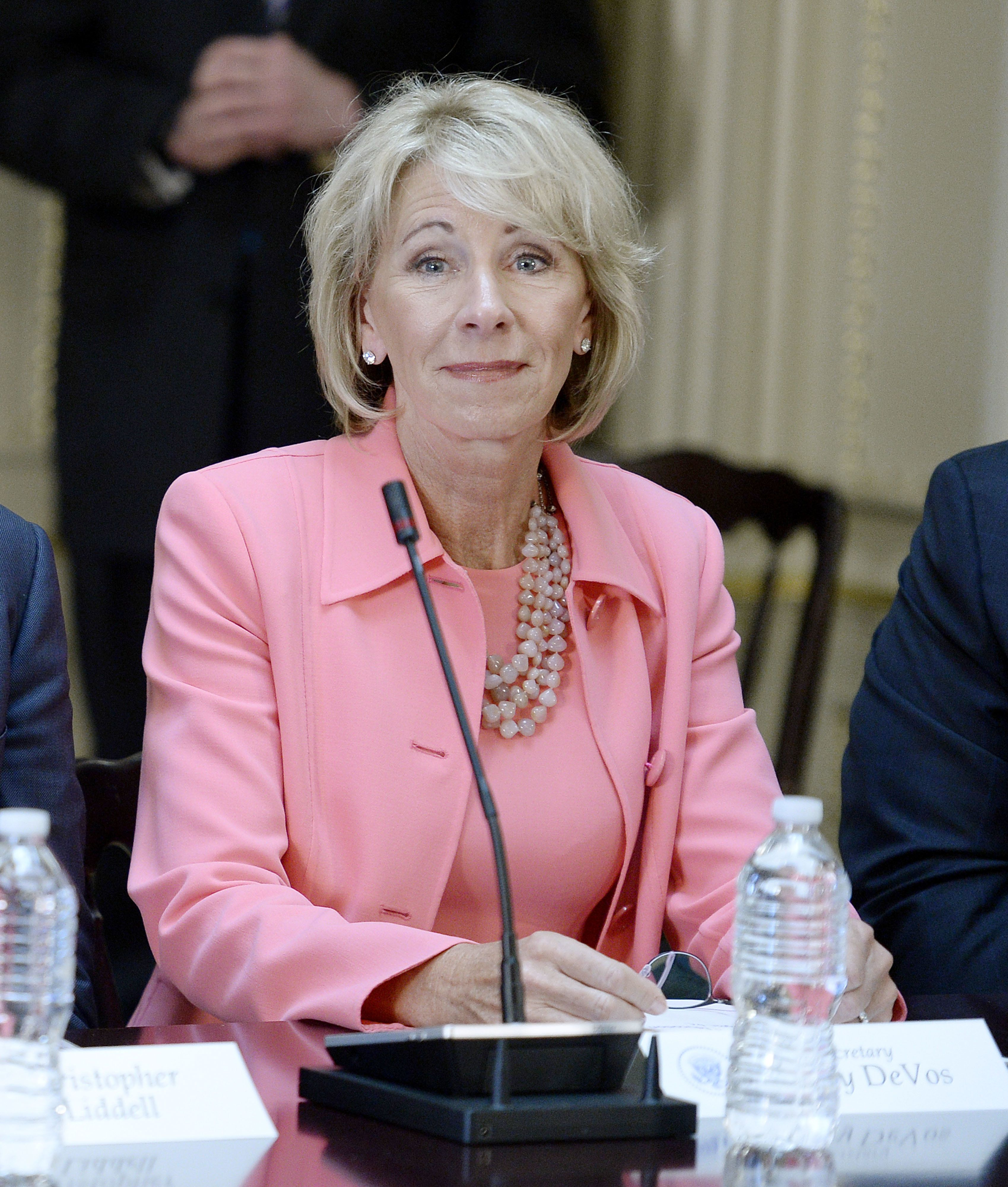 Betsy DeVos, U.S. secretary of education, listens during a strategic and policy discussion with U.S. President Donald Trump, not pictured, and executives at the White House in Washington, D.C., U.S., on Tuesday, April 11, 2017. The Trump administration has been hobbled by botched policy roll-outs and an early failure on another signature promise -- health-care reform -- and it remains to be seen whether Trump's infrastructure pledges can translate to a permanent boost for business. Photographer: Olivier Douliery/Pool via Bloomberg