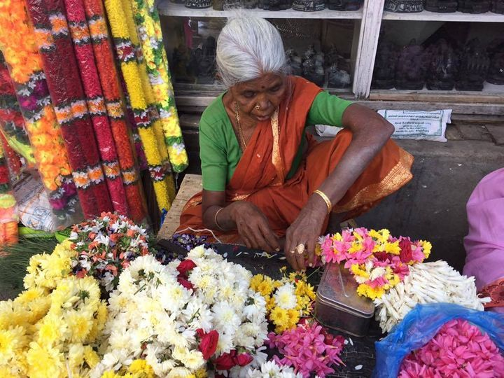 A woman prepares offerings for the Goddess