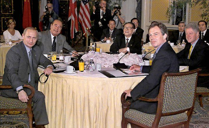Russian President Vladimir Putin, left, French President Jacques Chirac, Chinese President Jiang Zemin, British Prime Ministe