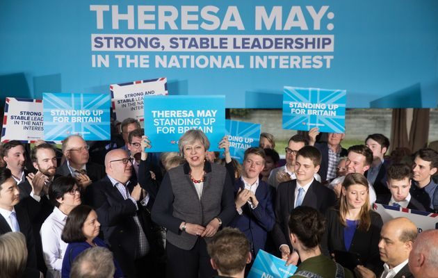Theresa May addresses an audience of supporters during a campaign stop in