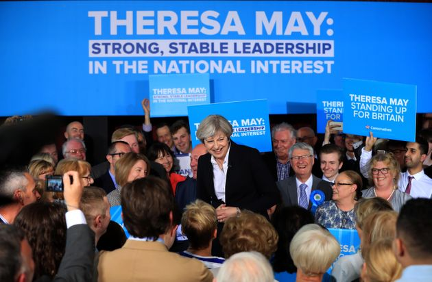Theresa May addresses an audience of supporters during a campaign stop inOrmskirk, West