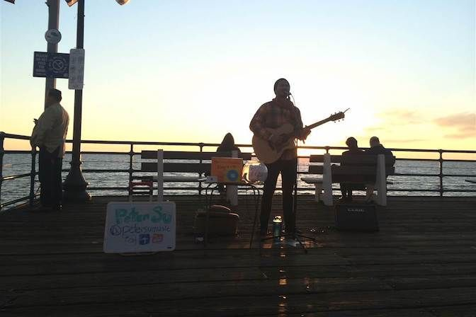 <strong><em>Busker at sunset on Santa Monica Pier — looking for connection</em></strong>