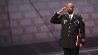 ATLANTA, GA - APRIL 28:  David Clarke Jr., sheriff of Milwaukee County, Wisconsin, salutes as he leaves the stage after speaking at the NRA-ILA's Leadership Forum at the 146th NRA Annual Meetings & Exhibits on April 28, 2017 in Atlanta, Georgia. The convention is the largest annual gathering for the NRA's more than 5 million members.  (Photo by Scott Olson/Getty Images)
