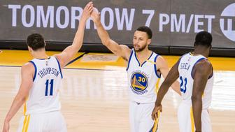 Apr 19, 2017; Oakland, CA, USA; Golden State Warriors guard Klay Thompson (11) high fives guard Stephen Curry (30) with forward Draymond Green (23) during the first quarter in game two of the first round of the 2017 NBA Playoffs at Oracle Arena. Mandatory Credit: Kelley L Cox-USA TODAY Sports