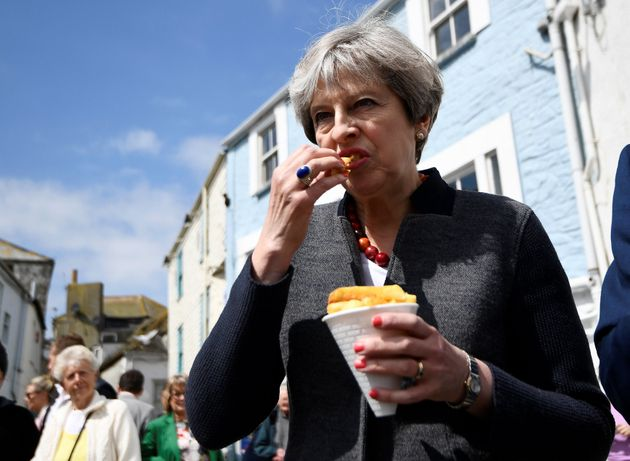 Theresa May Mocked For Eating Chips, And Ed Miliband Feels Her