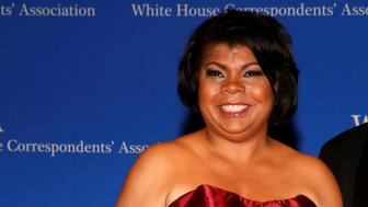Radio reporter April Ryan (L) arrives on the red carpet at the White House Correspondents' Association dinner in Washington, U.S. April 29, 2017. REUTERS/Jonathan Ernst