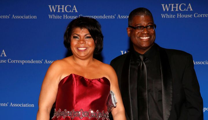 Radio reporter April Ryan, left, arrives on the red carpet at the White House Correspondents' Association dinner.