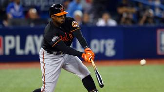 TORONTO, ONTARIO - OCTOBER 4: Adam Jones #10 of the Baltimore Orioles bats during the American League Wild Card Game against  the Toronto Blue Jays at the Rogers Centre on Tuesday, October 4, 2016 in Toronto, Ontario. (Photo by Alex Trautwig/MLB Photos via Getty Images)