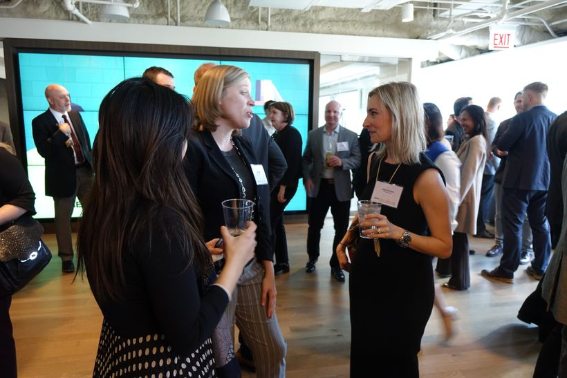 Melissa Morris, Furniture Advisor with CBRE and key organizer of the event chats with guests at the pre-discussion happy hour
