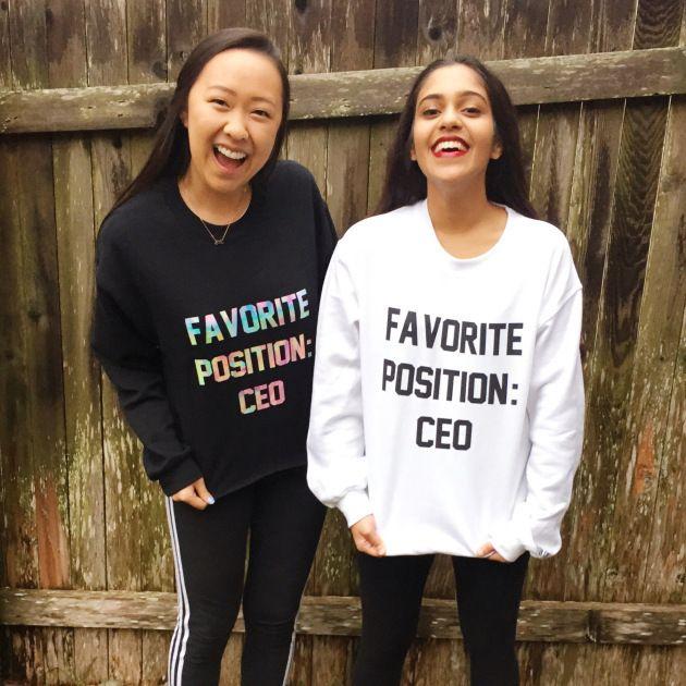 <em>Angela Jin and Nishiki Maredia model sweatshirts of their own design. </em>