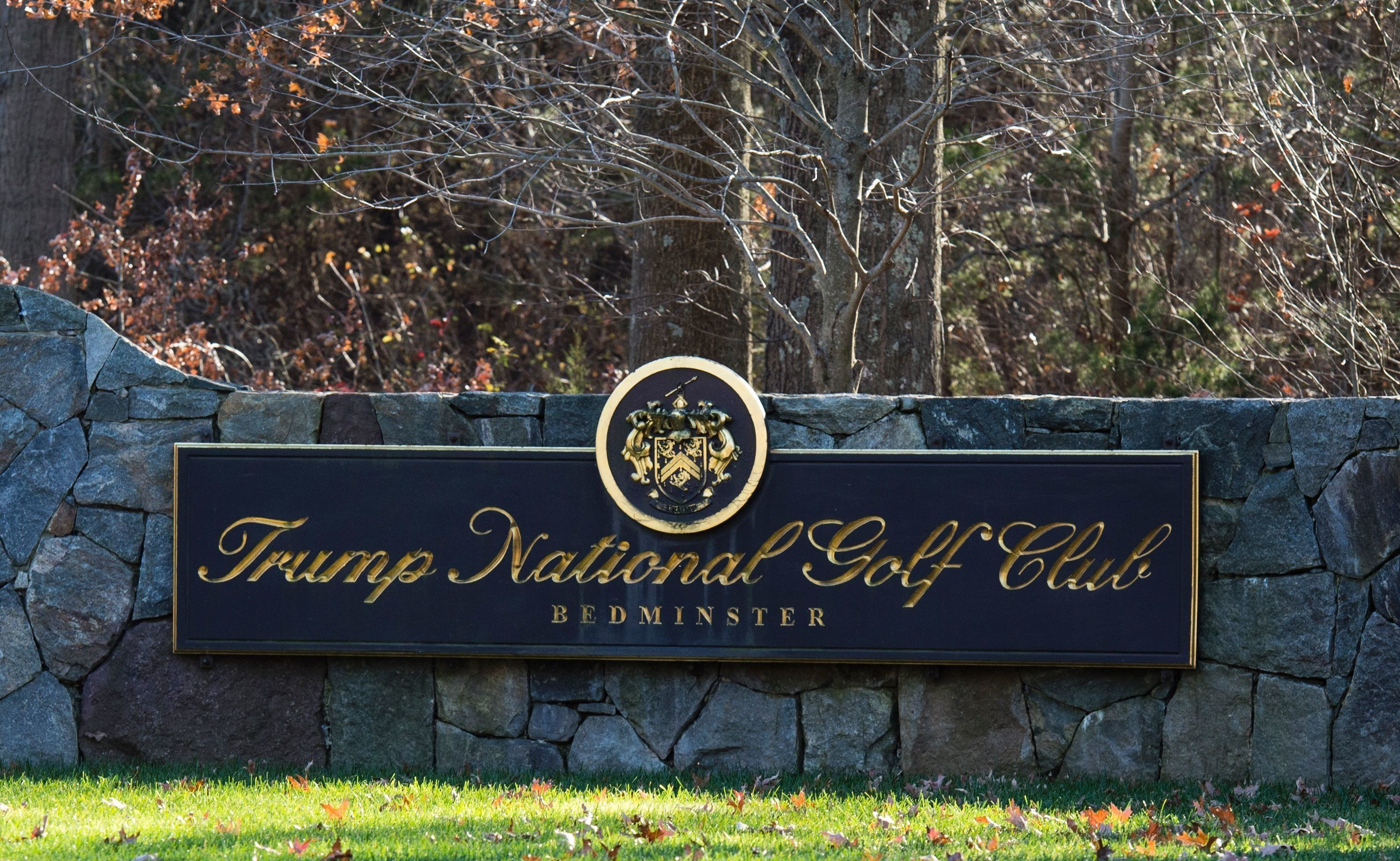 A sign on the stone wall greets visitors to the Trump National Golf Club on November 18, 2016 in Bedminster Township, New Jer