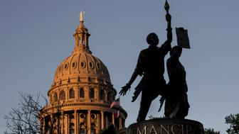 The Texas African-American History Memorial, right, and the Texas State Capitol building stand in Austin, Texas, U.S., on Tuesday, March 14, 2017. Austin has spent the last 10 monthsengaged ina bigexperimentin urban transportation.Several hundreds of thousands of people will descend upon Austin for the annual South by Southwest festival, a nine-day event that could be described as a tech conference, a music and film festival. Photographer: David Paul Morris/Bloomberg via Getty Images