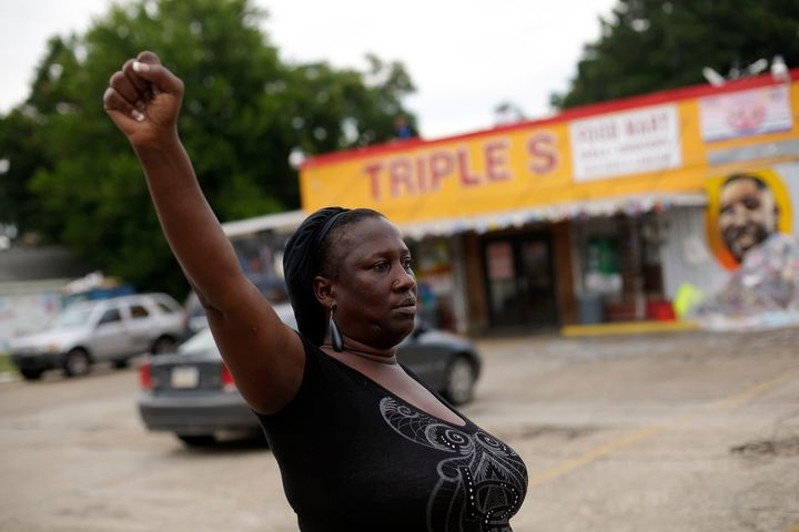Veda Washington protests the fatal police shooting of her nephew Alton Sterling outside the Triple S Food Mart.