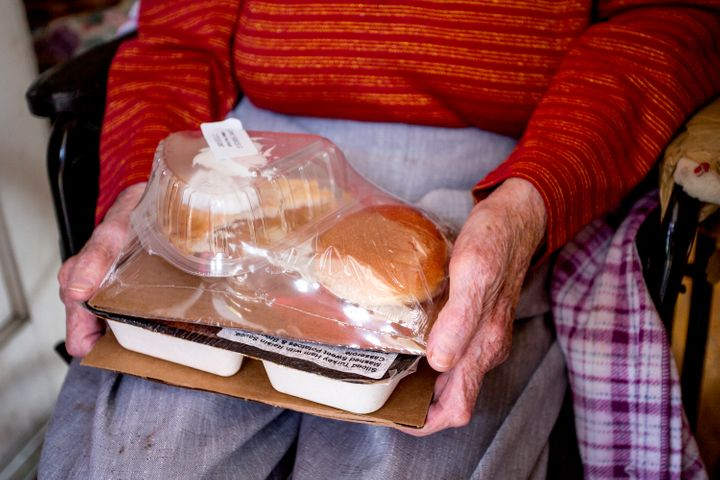 Josephine Hayward, 93, of Portland, holds a meal of ham with a raisin sauce, sweet potatoes, a broccoli casserole, bread, and