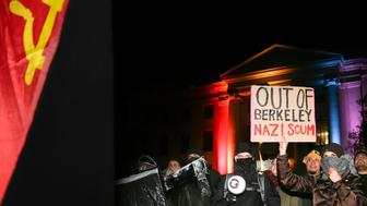 BERKELEY, CA - FEBRUARY 1: People protest controversial Breitbart writer Milo Yiannopoulos at UC Berkeley on February 1, 2017 in Berkeley, California. A scheduled speech by Yiannopoulos was cancelled after protesters and police engaged in violent skirmishes. (Photo by Elijah Nouvelage/Getty Images)