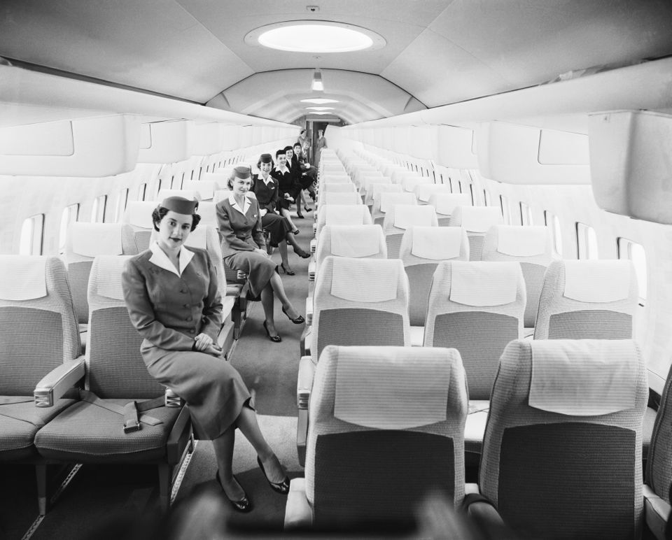 Gracing a luxurious mock-up of the Boeing Jet Stratoliner are a group of airline stewardesses. The half-million dollar m