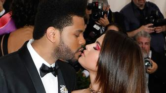 NEW YORK, NY - MAY 01:  The Weeknd kisses Selena Gomez at 'Rei Kawakubo/Commes Des Garcons: Art of the In-Between', the 2017 Costume Institute Benefit at Metropolitan Museum of Art on May 1, 2017 in New York City.  (Photo by Taylor Hill/FilmMagic)