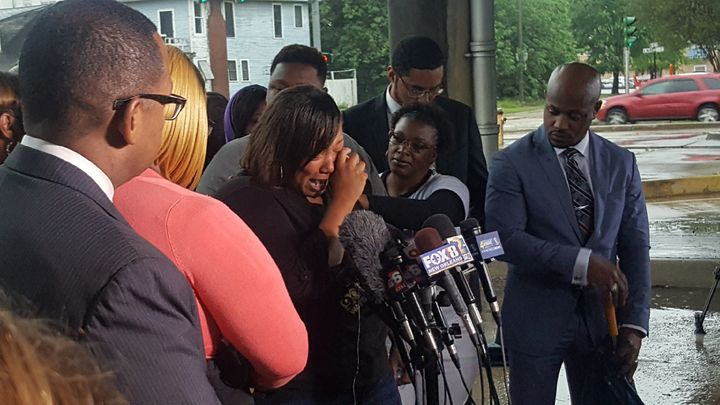 Alton Sterling's aunt, Sandra Sterling, cries at a news conference held by his family after the Department of Justice de