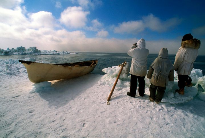Men of the Edwardsen crew look for whales in April 2001 in the outskirts of Barrow, Alaska.