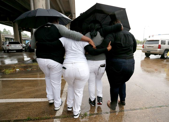 Relatives of Alton Sterling leave a news conference outside the Federal Court House in Baton Rouge, Louisiana, on Wednes