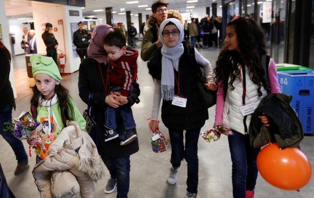 Syrian refugees arrive at Leonardo da Vinci International Airport in Rome Italy on January 30 2017 through humanitarian corridors