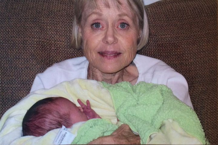 <p>My mom holding my firstborn in 2005.</p>